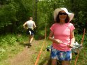 Laura Clark Taylor helps Runners at the New Intrsection at Hwy ZZ Aid Station : Saturday June 7th