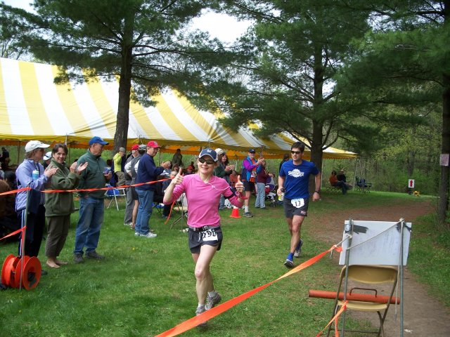 Kathleen Rytman of Cudahy, WI and Aaron Benike of Rochester, MN head into the finishing chute