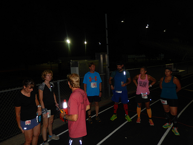 A surge in action as night time runners take to the track.