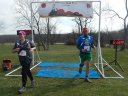 Kimmie Brown, veteran of two past Paleozoic Trail Runs, crosses the finish line of Silurian Spring!